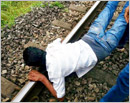Puttur: Wife saves husband from committing suicide on train-track by waving pallu