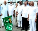 M'lore: Minister Roshan Baig flags-off AIE Flight carrying first batch of Haj Pilgrims