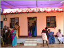Udupi/M'belle:  A kind person helps an impoverished family with  a permanent shelter