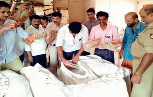 Election flying squad raids cooperative bank, 1,222 saris seized